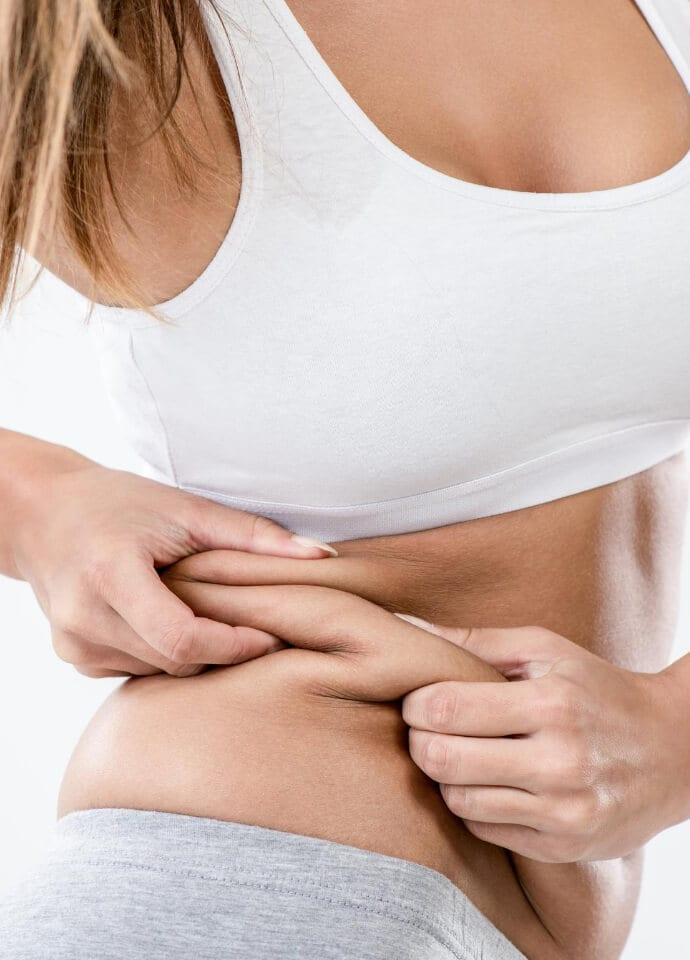 What Are Love Handles And What Causes Them? - non surgical love handle treatment 690x960 1